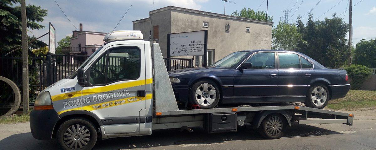 Besthol laweta transportująca pojazd, pomoc drogowa Warszawa, holowanie i transportowanie aut oraz motorów. Całodobowy warsztat samochodowy z dojazdem